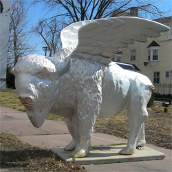 Statue of a buffalo with wings.