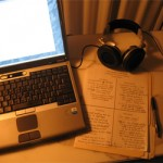 Laptop, papers and headphones