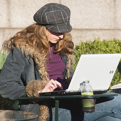 Student outdoors with laptop